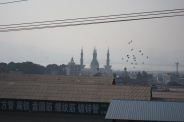 On our way to Kunming, we passed a few Muslim towns with beautiful mosques, road signs were in Chinese and in Arab