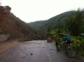 Small landslide blocking the road, no detour possible and it would take all day to clear the rubble. Everyone waited without complaining. While we admired their patience, we couldn't have that so a helpful lady helped us stop the diggers and we could carry our panniers and bikes over the landslide